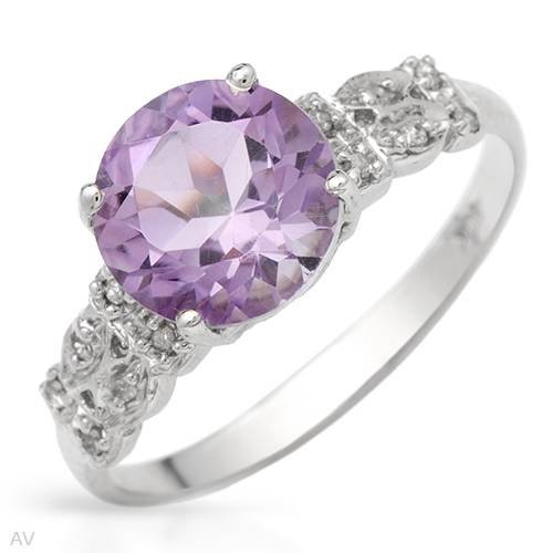 White Gold 1.69 CTW Amethyst and 0.06 CTW Color H-I I2 Diamond Ladies Ring. Ring Size 7. Total Item weight 2.0 g.