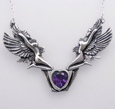 A Pair of Sterling Silver Fairies and an Amethyst Heart Made in America