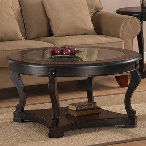 Geurts Espresso Coffee Table. This Dining Room Table Makes An Excellent Modern Furniture Piece Guaranteed. With A Smooth Espresso Finish, This Contemporary Glass Table Compliments Any Living Room Furniture Decor. A Small Round Table Of Elegance.