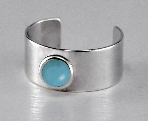 A Delightful Sterling Silver Ear Cuff Accented with Genuine Turquoise