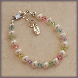 Precious sterling silver bracelet with soft white freshwater pearls and beautiful multi-color lead-free crystal - Gorgeous pearls with a touch of color!
