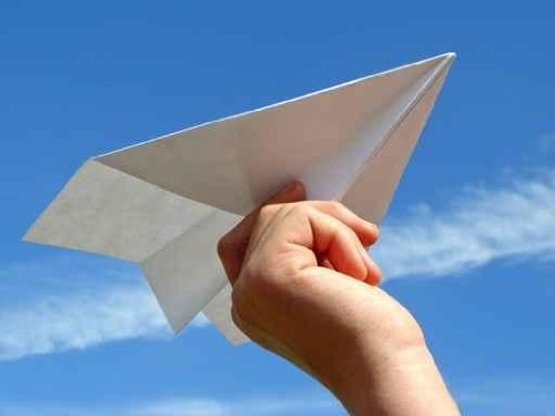 Child Hand with Paper Plane - 24
