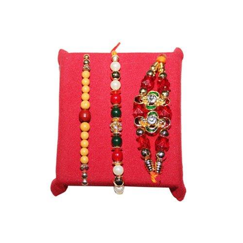 handicrunch-set-of-3-classic-pearls-and-beads-work-rakhi-with-haldirams-rasgulla