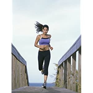 Young Woman Running with Headphones Photographic Poster Print