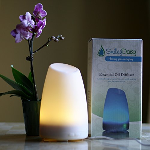 Aromatherapy Essential Oil Diffuser by Smiley Daisy® - Best Electric Ultrasonic Diffuser for Your Scented Oils (Eucalyptus, Lavender, etc.) - Free eReport Download - Best Candle Burner Replacement - Your Purchase Supports Charity - 180-Day Product Replacement Warranty When You Purchase with Smiley Daisy (White)