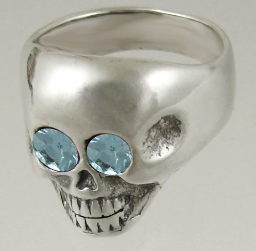 A Striking Sterling Silver Skull Featuring Two Faceted Blue Topaz Gemstone Eyes