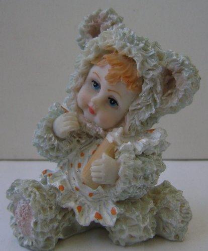 Ceramic Poly Baby in Teddy Bear Costume Figurine