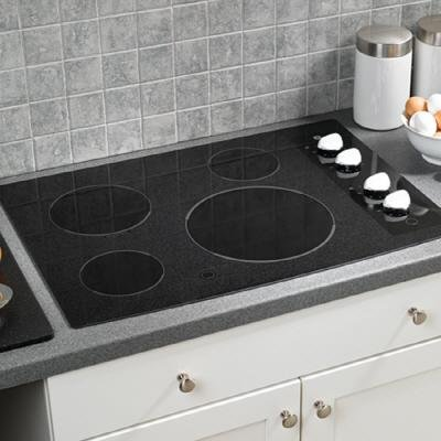 GE CleanDesign JP346WMWW 30 Smoothtop Electric Cooktop – Black Surface with White Accents  ->  GE Consumer and Industrial spans the globe as an i