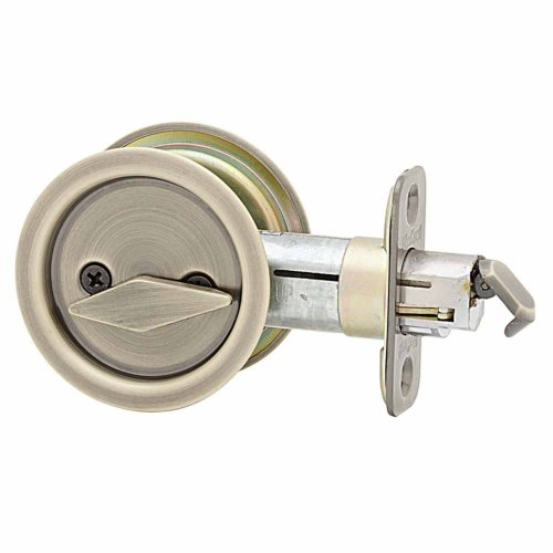 Kwikset 335 Round Bed/Bath Pocket Door Lock In Antique Brass front-399159
