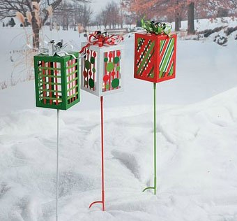 decorate your lawn for christmas with our present shaped yard stakes each jingle bell topped metal box has a tealight holder inside - Christmas Light Yard Stakes