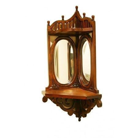CAL FUSTER - Ménsula esquinera de madera maciza de caoba con talla. Medidas totales: 90x45x30 cm.