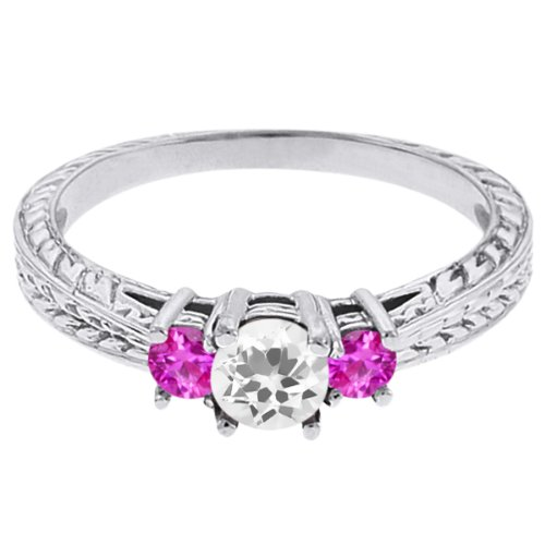 0.59 Ct Round White Topaz Pink Sapphire 18K White Gold 3-Stone Ring