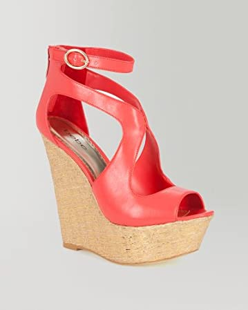 bebe | Caitlyn Metallic Woven Wedge Sandal from bebe.com