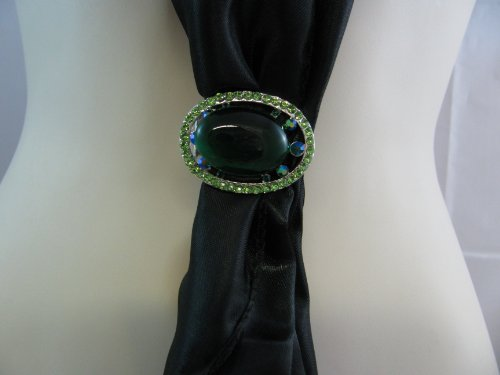 Silver effect scarf clip decorated with green diamonte stones and large emerald green gem stone.