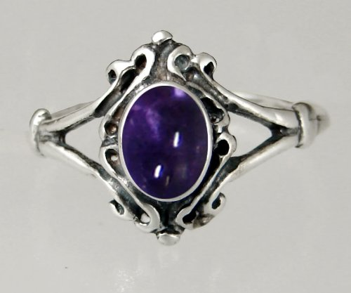An Elegant Sterling Silver Victorian Ring Featuring a Lovely Iolite Gemstone
