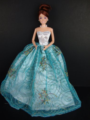 A Blue Ball Gown with Floral and Gold Details Made to Fit the Barbie Doll