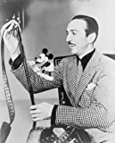 1935 Walt Disney, seated, examines film with Mickey Mouse perched on his righ d6