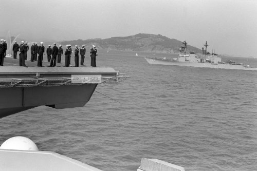 Photo Crewmen Stand On The Flight Deck Of The Nuclear-Powered Aircraft Carrier Uss Enterprise (Cvn 65) As It Passes The Spruance Class Destroyer Uss O'Brien (Dd 975), 10/15/1983