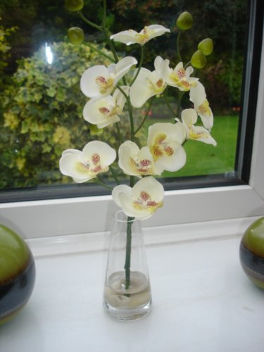 artificial silk orchid in a glass vase