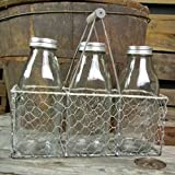 Chicken wire basket, wood handle, three glass milk bottles with lid