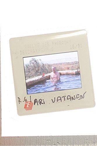 slides-photo-of-ari-vatanen-bathing-on-the-pool