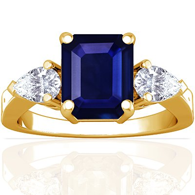 18K Yellow Gold Emerald Cut Blue Sapphire Three Stone Ring