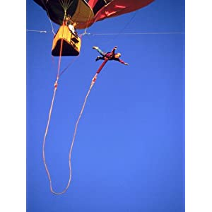 Man Bungee Jumping from a Hot Air Balloon Photographic Poster Print
