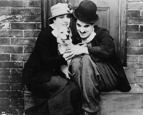 "Edna Purviance with Charlie Chaplin in ""A Dog's Life"""