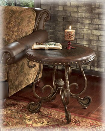 Rich with the beauty of Old World design, the grand traditional style of the Rafferty accent table collection transforms any living area with a comforting elegance. The dark stained wood framed table tops feature nailhead trim and etched metal accents to capture the essence of traditional styled furniture.