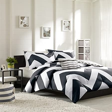 The Libra comforter adds a dramatic pop to your bedroom with a bold black and white chevron print that creates a fun vibrant look to any bedroom. A smaller scale gray and white chevron print covers the reverse. Made from polyester microfiber and cott...