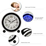 DreamSky Non Ticking Quartz Analog Alarm Clock With Nightlight And Snooze, Loud Music Alarms,Simple To Set Clocks, Small Bedside Alarm Clock ,Battery Powered (Black)