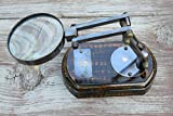 Desktop magnifying glass with brass detail on a wood stand