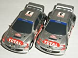 Micro Scalextric - Pair of Ford Focus WRC Rally Cars (BP Abu Dhabi and Eddie Stobart) - 1/64th Scale Slot Cars