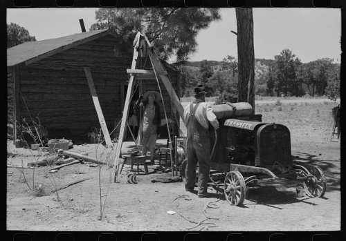 Farmer,his wife drilling water well with cable tools,Pie Town,New Mexico