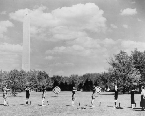 1933 photo Archery south of Reflecting Pool, West Potomac Park graphic. Photograph shows young women