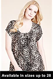 Lady Wearing Animal Print Plus Size Shirt
