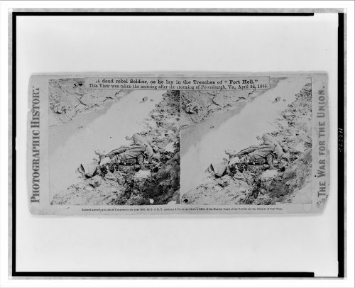 Stereoview (L): A dead rebel soldier as he lay in the trenches of Fort Hell--This view was taken th