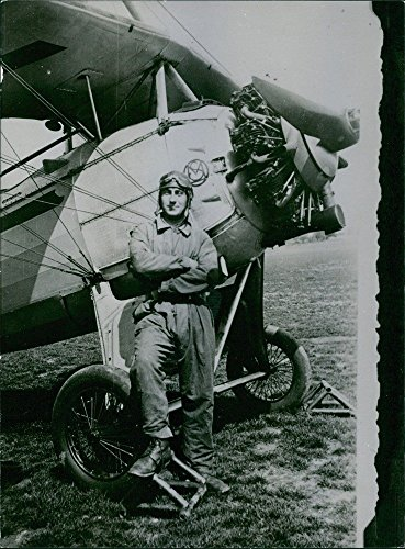 vintage-photo-of-man-strike-a-pose-beside-an-aircraft-during-the-war-usa