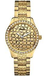 GUESS Women's U0236L2 Feminine Animal Gold-Tone Sport Watch