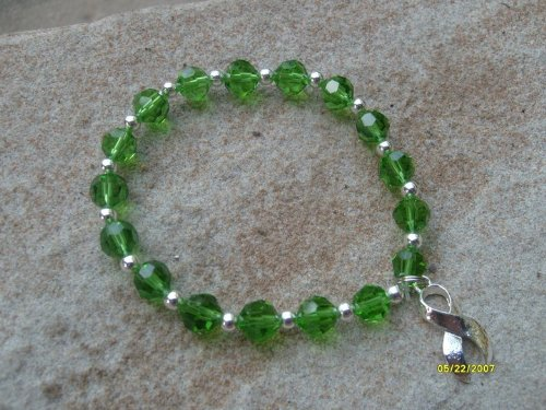Green Glass Bead Awareness Bracelet - (Fundraising Idea) Tissue and Organ Donation Depression (Both Adults and Children) Bipolar Disorder Mental Health or Illness Eye Injuries Tourette's Syndrome Bone Marrow (Transplants and Donation) Worker and Driving Safety Glaucoma Missing Children Leukemia Environment Kidney Cancer Kidney Disease Neural Tube Defects Cerebral Palsy Neurofibromatosis