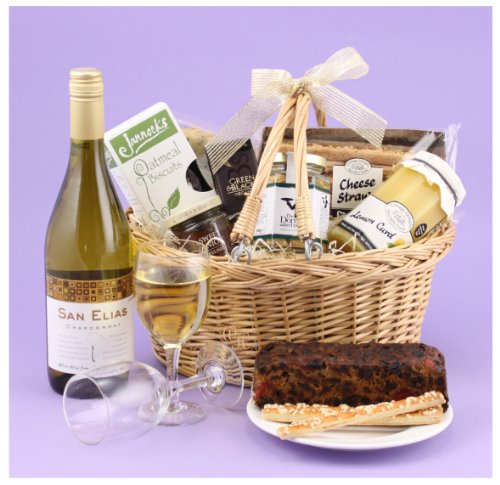 Basket of Treats - traditional willow shopping basket with a bottle of chardonnay, chocolate, fruit cake and other tasty treats all presented in a clear giftwrapped and ribboned shopping basket for a delightful present whatever the occasion. From Food Hampers by Web Hampers