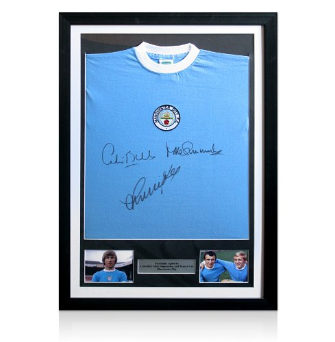 Framed Manchester City shirt signed by Bell, Summerbee & Lee
