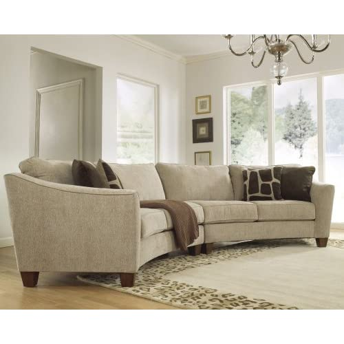Curves stone 2 piece curved sectional sofa by ashley for Curved sectional sofa amazon