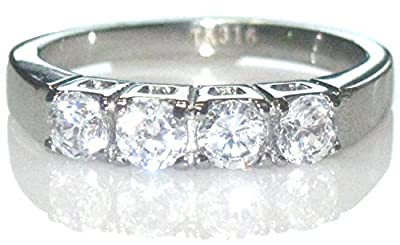Ah! Jewellery Stainless Steel Lab Created Diamond Ring. 4 Individual Lab Diamonds in a Row. Stamped 316. Total Weight of 2.5gr. Total Width of 4mm. Never Tarnish. Marvellous Quality.