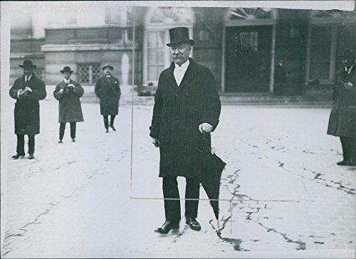 vintage-photo-of-louis-marin-standing-in-street-and-looking-at-something