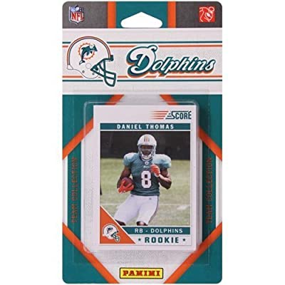 2011 Score Miami Dolphins Factory Sealed 12 Card Team Set. Players Include Ronnie Brown, Ricky Williams, Karlos Dansby, Jake Long, Davone Bess, Chad Henne, Cameron Wake, Brandon Marshall, Anthony Fasano, Daniel Thomas, Clyde Gates and Mike Pouncey.