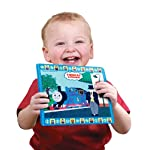 Child smiling holding Tomy Aqua Draw Mini Mats - Thomas & Friends