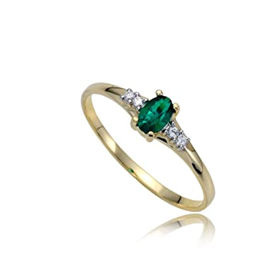 Emerald and zirconia engagement ring