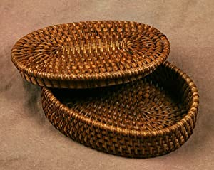 small oval rattan basket with lid indonesian home storage baskets. Black Bedroom Furniture Sets. Home Design Ideas