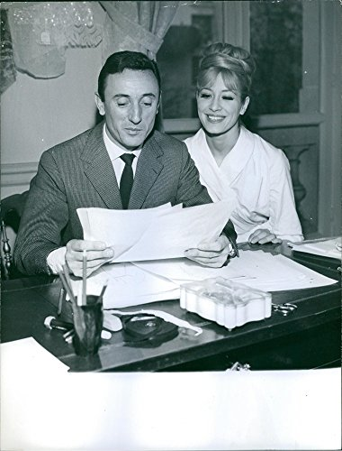 vintage-photo-of-guy-laroche-sitting-with-a-woman-and-looking-at-papers-smiling-1962